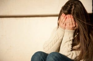 Symptoms of PTSD in adolescents may include anxiety, depression, and sleeplessness.