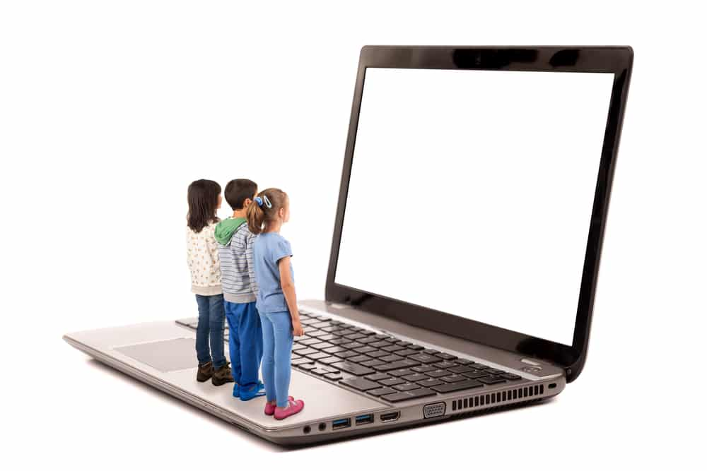 Kids watch computer screen
