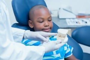 demonstrate toothbrushing
