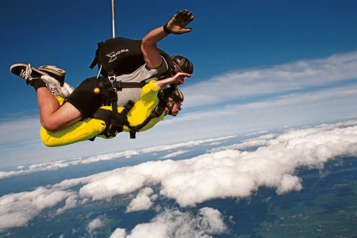 The author faced her fear of heights by jumping from a plane.