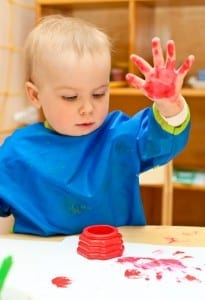 A toddler will be fascinated by his own handprint, made with fingerpaint.