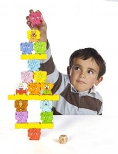 Making a Zimbbos pyramid (photo courtesy: Blue Orange Games), board games