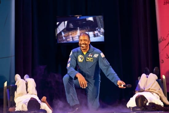 Dr. Harris on stage promoting The DREAM Tour in Harlem, allowing two students to experience the thrust of the rocket taking off! (courtesy)