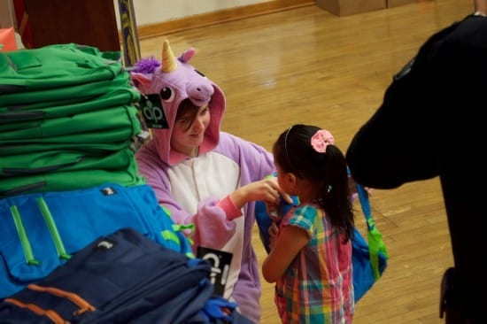 Riley Gantt, pitching in at a Rainbow Pack backpack giveaway (courtesy).