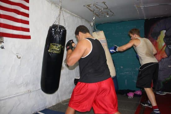 Boys punching bags in a gym