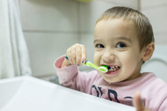 Cute little boy brushes his teeth