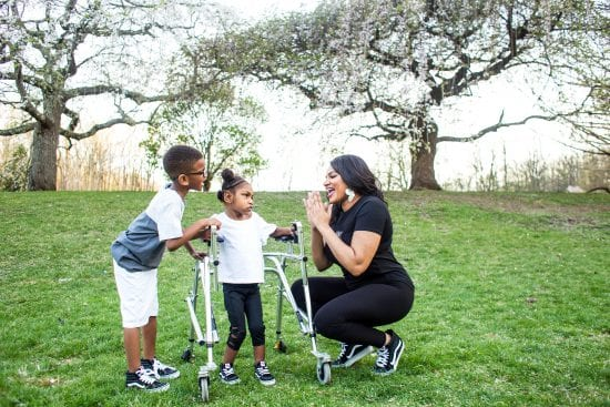 Single parent Melanie Oates with her special needs twins Julius and Genell