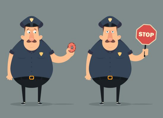 Policeman holding stop sign