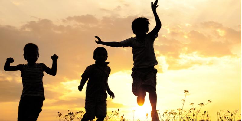 children playing in summer sunset