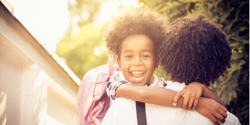 Back to School Hug black father child
