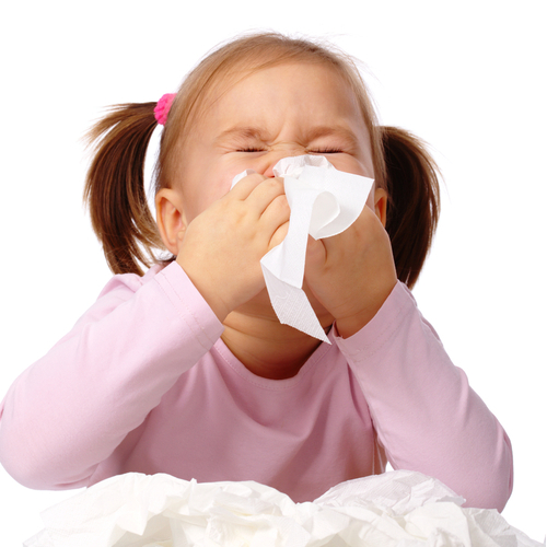 Little girl tries to blow her nose