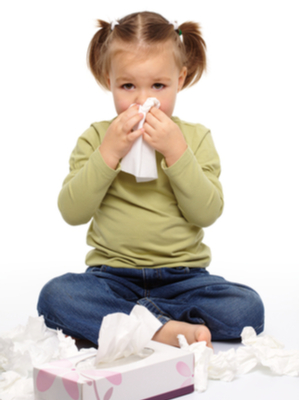 little girl blows nose using endless tissues