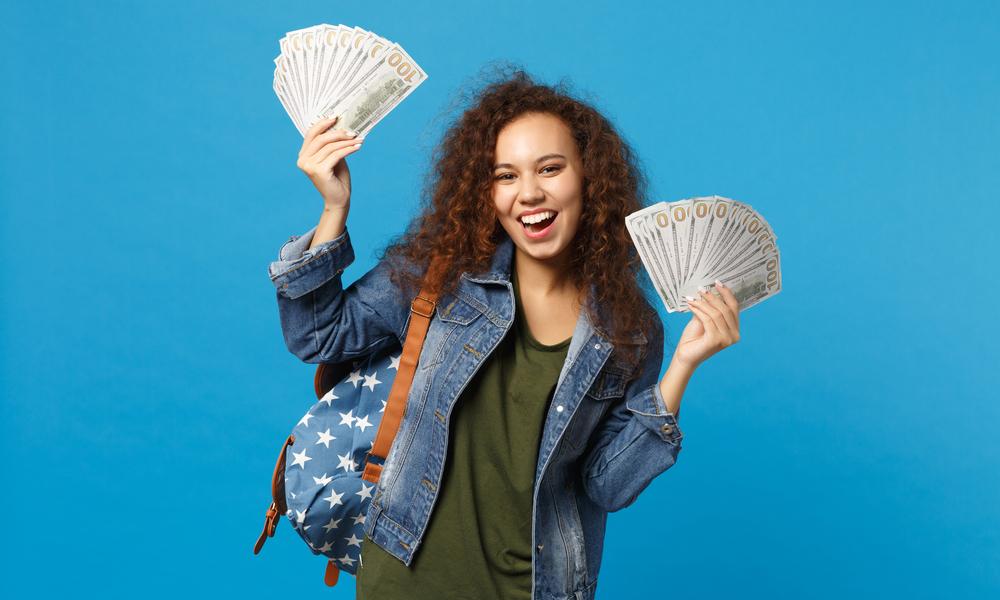 when do you stop giving kids an allowance student holds bills