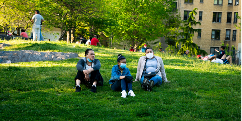 masked family in NYC park during COVID-19